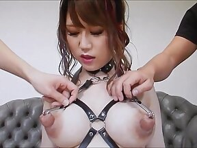 Asian beauty strokes her nipples